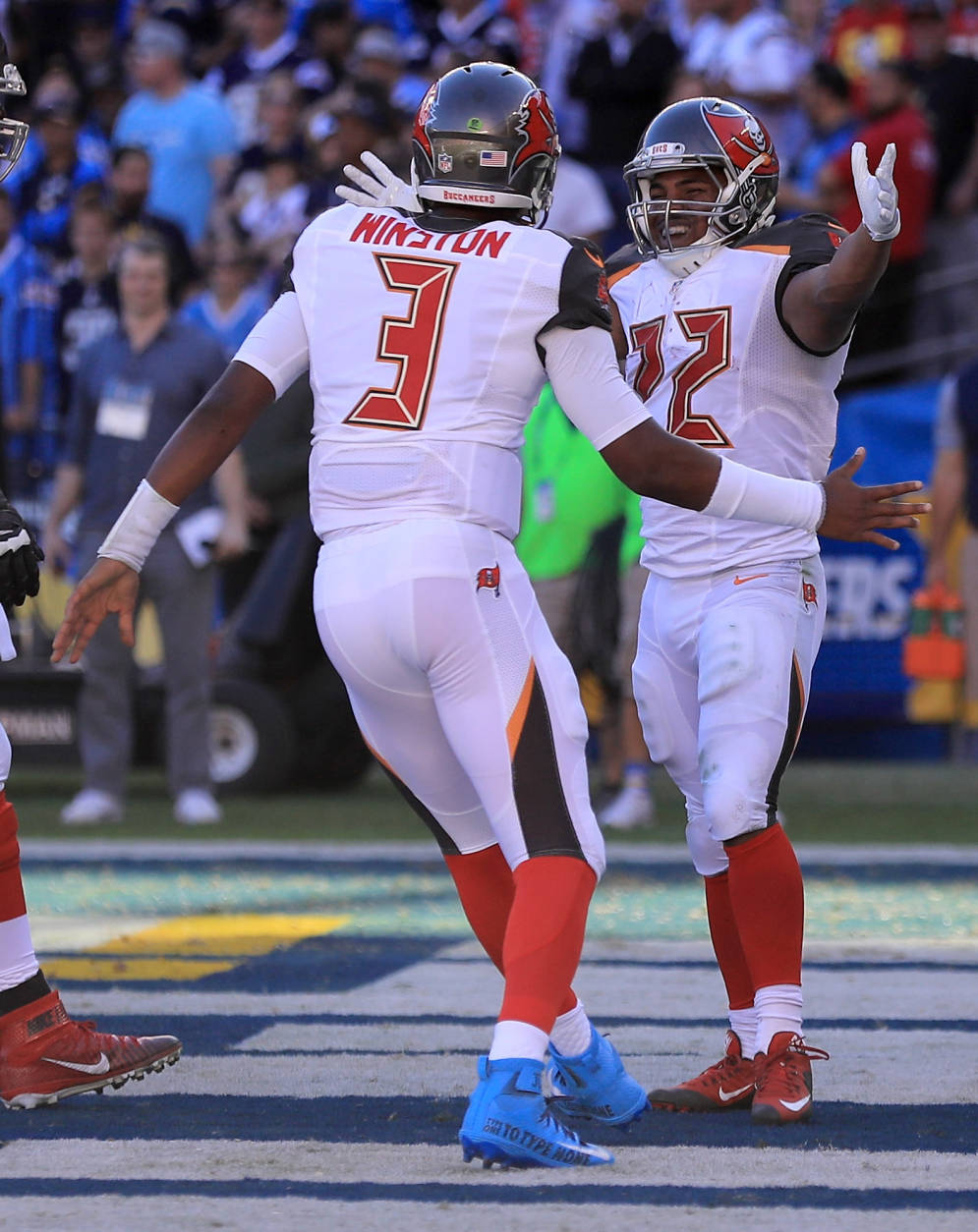 SAN DIEGO, CA - DECEMBER 04:  Jameis Winston #3 reacts with  Doug Martin #22 of the Tampa Bay Buccaneers afrer scoring against the San Diego Chargers during the first half of a game at Qualcomm Stadium on December 4, 2016 in San Diego, California.  (Photo by Sean M. Haffey/Getty Images)