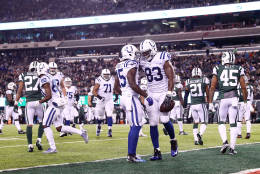 EAST RUTHERFORD, NJ - DECEMBER 05:  Dwayne Allen #83 celebrates his second touchdown in the first quarter against the New York Jets with teammate  Phillip Dorsett #15 of the Indianapolis Colts during their game at MetLife Stadium on December 5, 2016 in East Rutherford, New Jersey.  (Photo by Elsa/Getty Images)