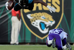 JACKSONVILLE, FL - DECEMBER 11:   T.J. Yeldon #24 of the Jacksonville Jaguars gets airborne on a tackle by Terence Newman #23 of the Minnesota Vikings during the game at EverBank Field on December 11, 2016 in Jacksonville, Florida.  (Photo by Sam Greenwood/Getty Images)