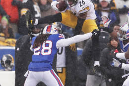 ORCHARD PARK, NY - DECEMBER 11:  Le'Veon Bell #26 of the Pittsburgh Steelers jumps over  Ronald Darby #28 of the Buffalo Bills during the second half at New Era Field on December 11, 2016 in Orchard Park, New York.  (Photo by Brett Carlsen/Getty Images)