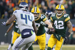 GREEN BAY, WI - DECEMBER 11: Morgan Burnett #42 of the Green Bay Packers intercepts a pass during the game against the Seattle Seahawks at Lambeau Field on December 11, 2016 in Green Bay, Wisconsin.  (Photo by Dylan Buell/Getty Images)