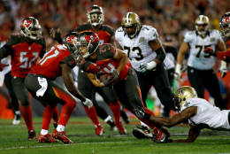 TAMPA, FL - DECEMBER 11:  Cornerback Brent Grimes #24 of the Tampa Bay Buccaneers is stopped by wide receiver Brandon Coleman #16 of the New Orleans Saints after intercepting a pass by quarterback Drew Brees during the fourth quarter of an NFL game on December 11, 2016 at Raymond James Stadium in Tampa, Florida. (Photo by Brian Blanco/Getty Images)