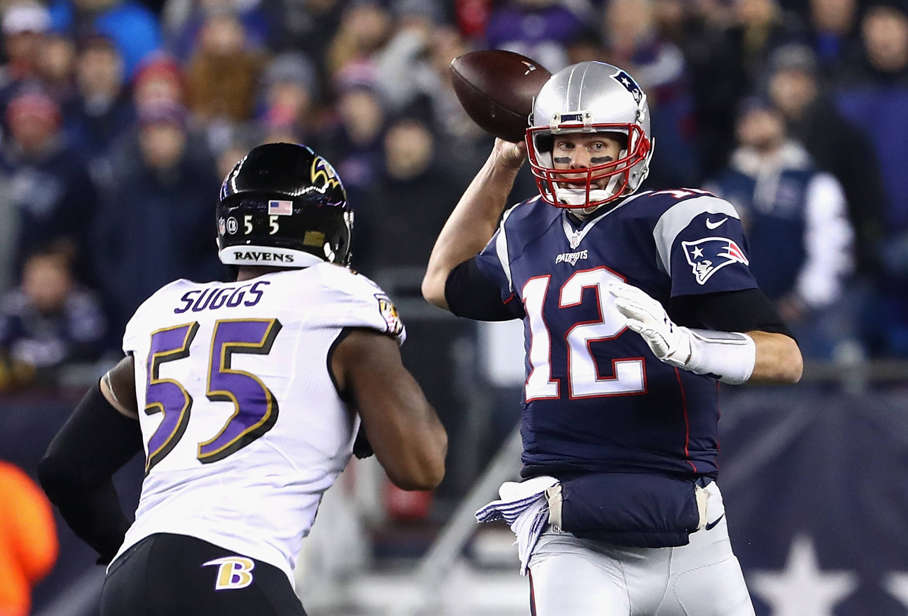 FOXBORO, MA - DECEMBER 12:  Tom Brady #12 of the New England Patriots throws a pass as he is pressured by Terrell Suggs #55 of the Baltimore Ravens during the first half of their game at Gillette Stadium on December 12, 2016 in Foxboro, Massachusetts.  (Photo by Adam Glanzman/Getty Images)