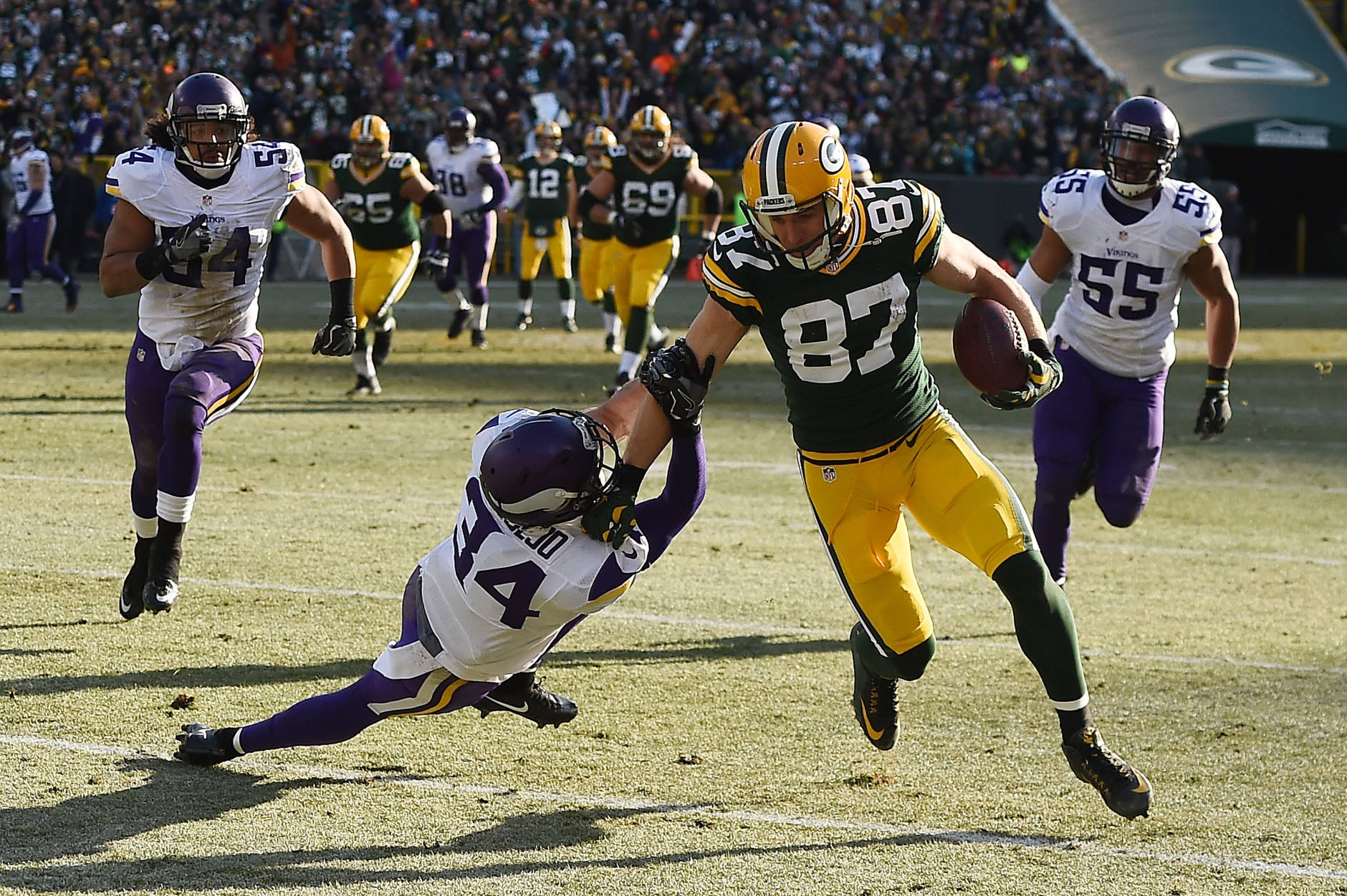 GREEN BAY, WI - DECEMBER 24:  Jordy Nelson #87 of the Green Bay Packers breaks a tackle by Andrew Sendejo #34 of the Minnesota Vikings during the second quarter of a game at Lambeau Field on December 24, 2016 in Green Bay, Wisconsin.  (Photo by Stacy Revere/Getty Images)