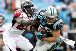 CHARLOTTE, NC - DECEMBER 24:   Greg Olsen #88 of the Carolina Panthers runs the ball against  Keanu Neal #22 of the Atlanta Falcons in the 2nd half during their game at Bank of America Stadium on December 24, 2016 in Charlotte, North Carolina.  (Photo by Streeter Lecka/Getty Images)