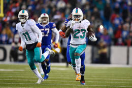 ORCHARD PARK, NY - DECEMBER 24:   Jay Ajayi #23 of the Miami Dolphins runs the ball against the Buffalo Bills during overtime at New Era Stadium on December 24, 2016 in Orchard Park, New York.  (Photo by Rich Barnes/Getty Images)