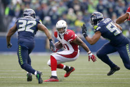SEATTLE, WA - DECEMBER 24:  Running back David Johnson #31 of the Arizona Cardinals rushes against the Seattle Seahawks at CenturyLink Field on December 24, 2016 in Seattle, Washington.  (Photo by Otto Greule Jr/Getty Images)