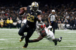 NEW ORLEANS, LA - DECEMBER 24:  Mark Ingram #22 of the New Orleans Saints is tackled by  Lavonte David #54 of the Tampa Bay Buccaneers at the Mercedes-Benz Superdome on December 24, 2016 in New Orleans, Louisiana.  (Photo by Jonathan Bachman/Getty Images)