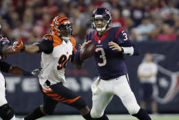 HOUSTON, TX - DECEMBER 24:  Carlos Dunlap #96 of the Cincinnati Bengals pressures Tom Savage #3 of the Houston Texans in the third quarter at NRG Stadium on December 24, 2016 in Houston, Texas.  (Photo by Tim Warner/Getty Images)