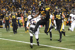 PITTSBURGH, PA - DECEMBER 25:  Le'Veon Bell #26 of the Pittsburgh Steelers leaps into the end zone in front of Eric Weddle #32 of the Baltimore Ravens for a 7 yard rushing touchdown in the fourth quarter during the game at Heinz Field on December 25, 2016 in Pittsburgh, Pennsylvania. (Photo by Joe Sargent/Getty Images)