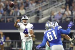 ARLINGTON, TX - DECEMBER 26: Dak Prescott #4 of the Dallas Cowboys throws as Kerry Hyder #61 of the Detroit Lions defends during the first half at AT&T Stadium on December 26, 2016 in Arlington, Texas. (Photo by Ronald Martinez/Getty Images)