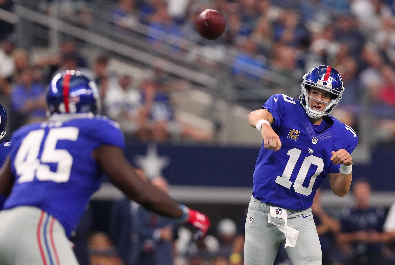 ARLINGTON, TX - SEPTEMBER 11:  Eli Manning #10 of the New York Giants throws a pass during the second half against the Dallas Cowboys at AT&T Stadium on September 11, 2016 in Arlington, Texas.  (Photo by Tom Pennington/Getty Images)