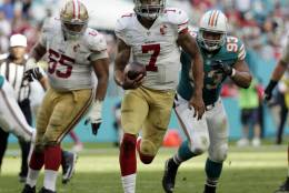San Francisco 49ers quarterback Colin Kaepernick (7) run the ball, during the second half of an NFL football game against the Miami Dolphins, Sunday, Nov. 27, 2016, in Miami Gardens, Fla. (AP Photo/Wilfredo Lee)