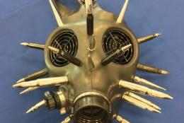 Post-apocalyptic bullet adorned gas mask — Miami International Airport (MIA)