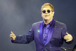 "FILE- In this Thursday, May 26, 2016, file photo, musician Elton John performs during a show in Tel Aviv. Elton John is giving filmmakers a chance to create music videos for his 1970s hits that were released before music videos were popular. The English singer announced Monday, Dec. 12, 2016, in celebration of he and songwriting partner Bernie Taupin's 50th anniversary, that he's launching a competition for aspiring video creators to make music videos for ""Rocket Man,"" ""Tiny Dancer"" and ""Bennie and the Jets."" (AP Photo/Dan Balilty, File)"