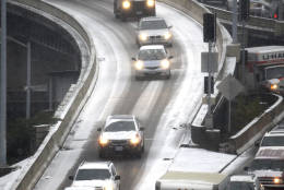 Traffic along the Interstate 5 and Interstate 84 interchange ramps are jammed after a snow storm moved in on the area in Portland, Ore., Wednesday, Dec. 14, 2016. A wintry afternoon and evening is forecast for much of Oregon, with some cities expected to get a foot of snow.(AP Photo/Don Ryan)