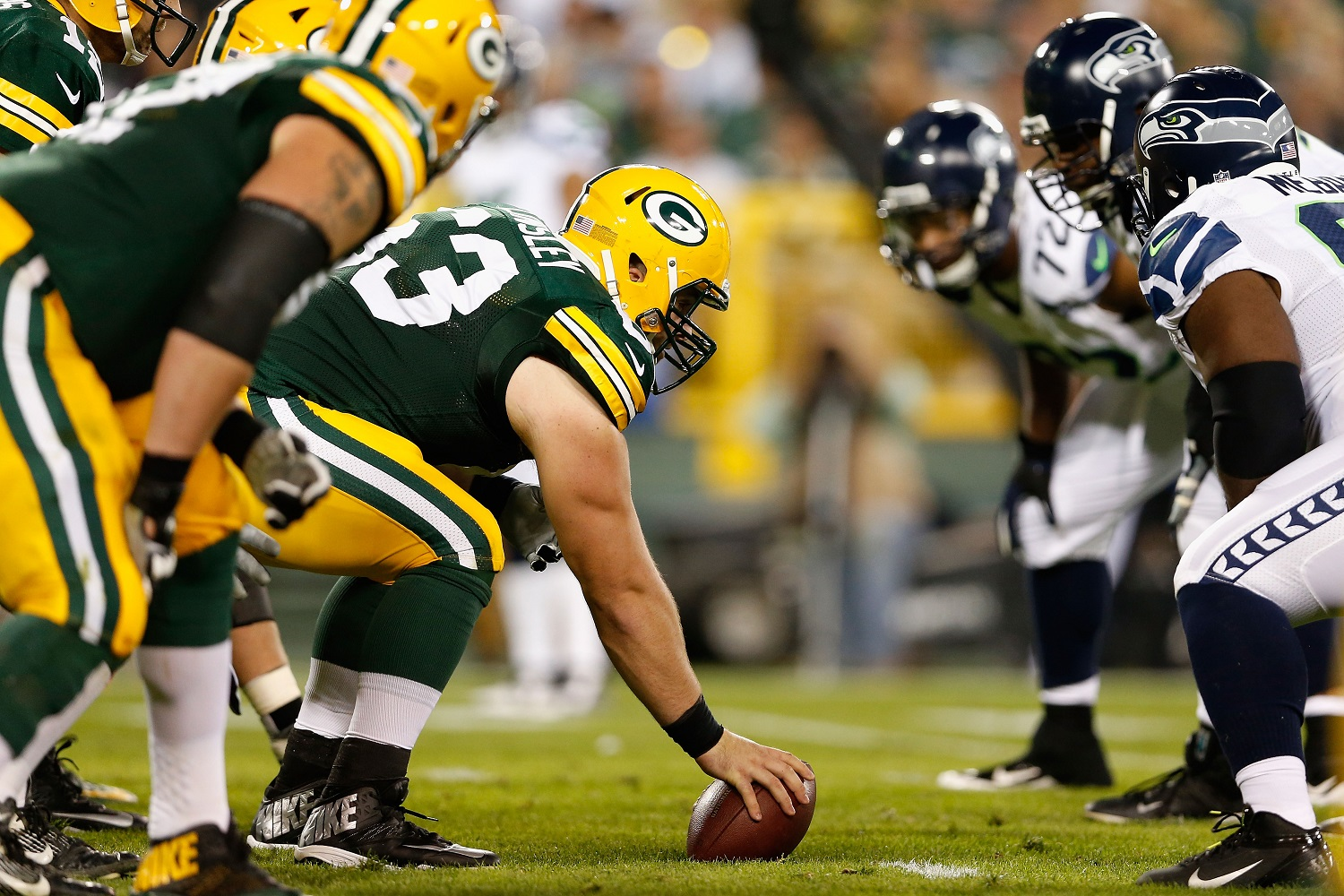 GREEN BAY, WI - SEPTEMBER 20:  Center Corey Linsley #63 of the Green Bay Packers prepares to snap the football against the Seattle Seahawks during the NFL game at Lambeau Field on September 20, 2015 in Green Bay, Wisconsin.  (Photo by Christian Petersen/Getty Images)