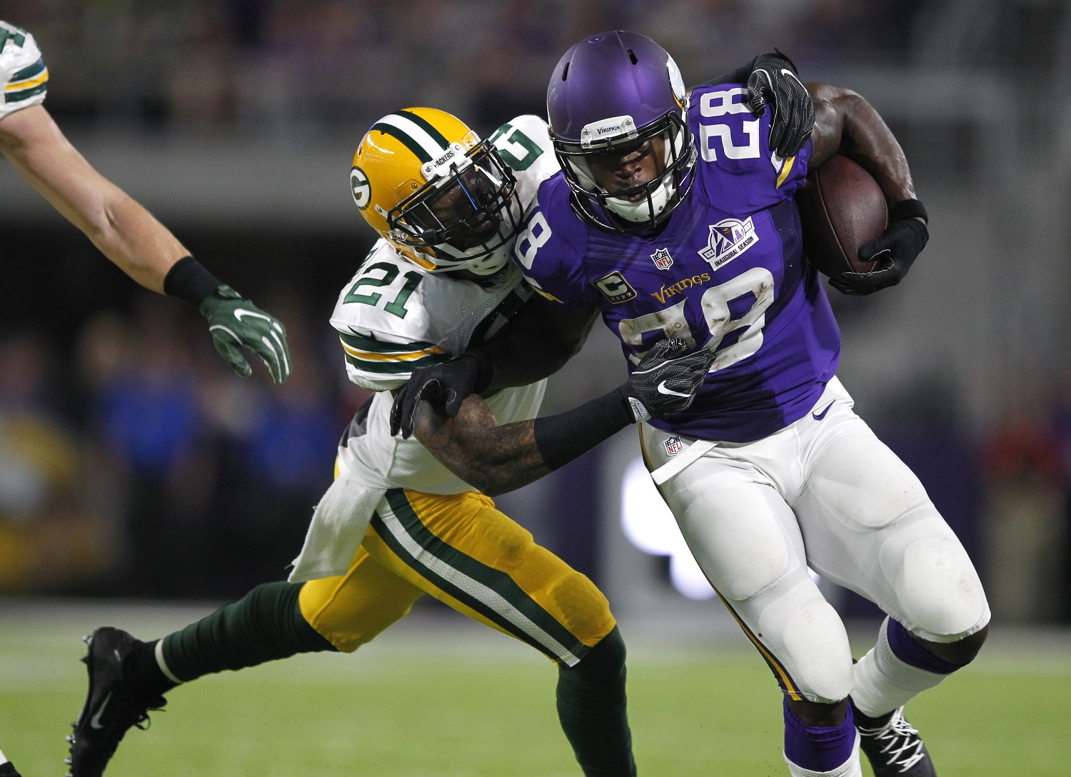 Minnesota Vikings running back Adrian Peterson (28) tries to break a tackle by Green Bay Packers free safety Ha Ha Clinton-Dix, left, during the first half of an NFL football game Sunday, Sept. 18, 2016, in Minneapolis. (AP Photo/Andy Clayton-King)