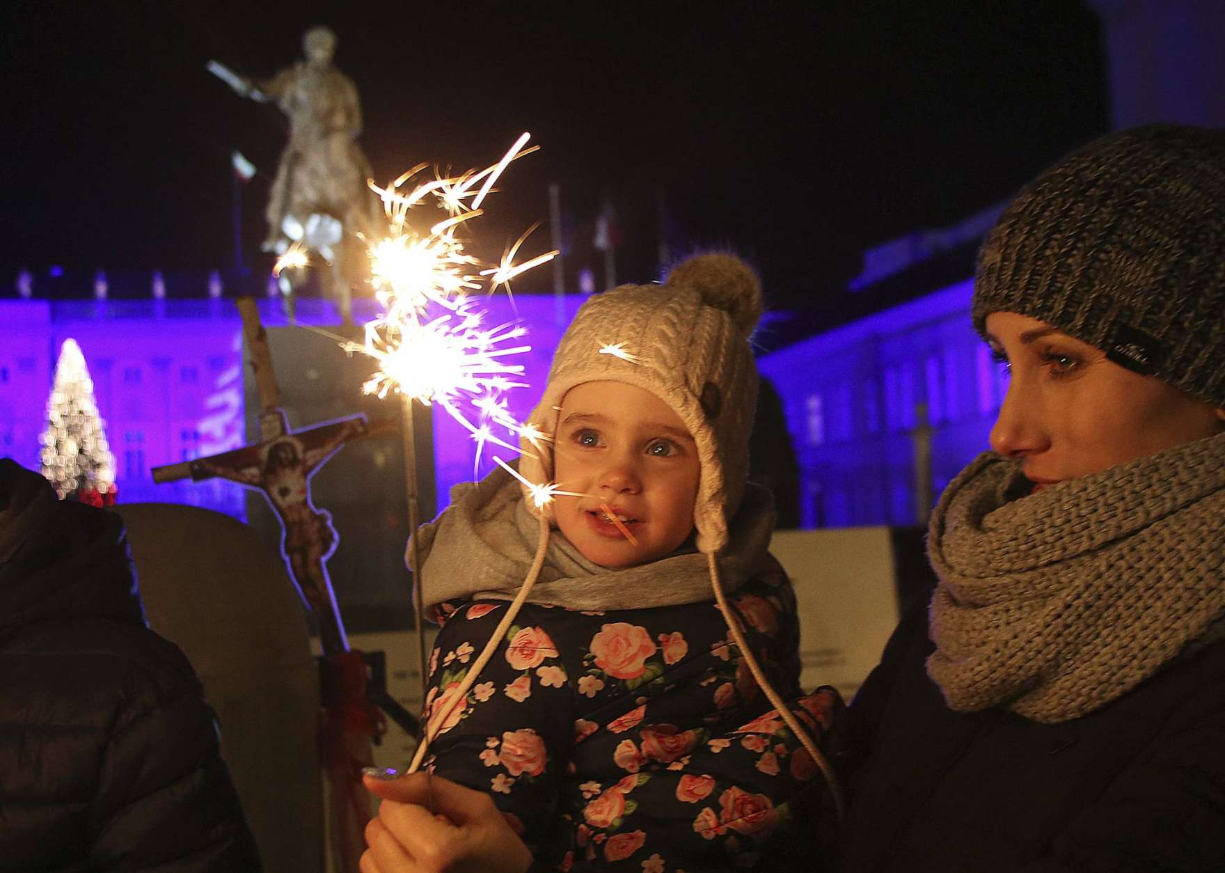 Spectators celebrate the New Year in front of the Presidential Palace in Warsaw, Poland, Sunday, Jan. 1, 2017. Thousands of Warsaw residents took to the streets in the capital to usher in the New Year.(AP Photo/Czarek Sokolowski)
