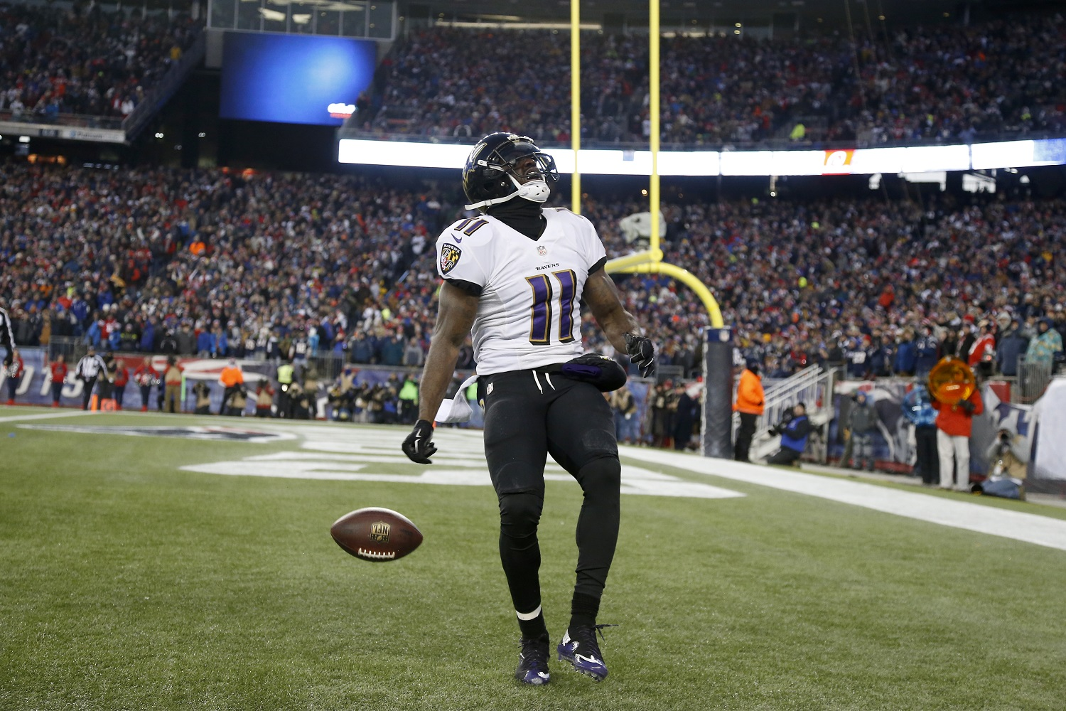 Baltimore Ravens wide receiver Kamar Aiken (11) celebrates his touchdown catch in the first half of an NFL divisional playoff football game against the New England Patriots Saturday, Jan. 10, 2015, in Foxborough, Mass. (AP Photo/Elise Amendola)