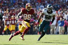 Washington Redskins wide receiver Pierre Garcon, left, rushes past Philadelphia Eagles middle linebacker Jordan Hicks in the first half of an NFL football game, Sunday, Oct. 16, 2016, in Landover, Md. (AP Photo/Alex Brandon)