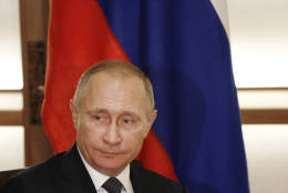 Russian President Vladimir Putin is seen in Nagato, western Japan, Thursday, Dec. 15, 2016. The Obama administration suggested Thursday that Putin personally authorized the hacking of Democratic officials' email accounts in the run-up to the presidential election, which intelligence agencies believe was designed to help Donald Trump prevail. The White House also leveled an astounding attack on Trump himself, saying he must have known of Russia's interference. (Toru Hanai/Pool Photo via AP)
