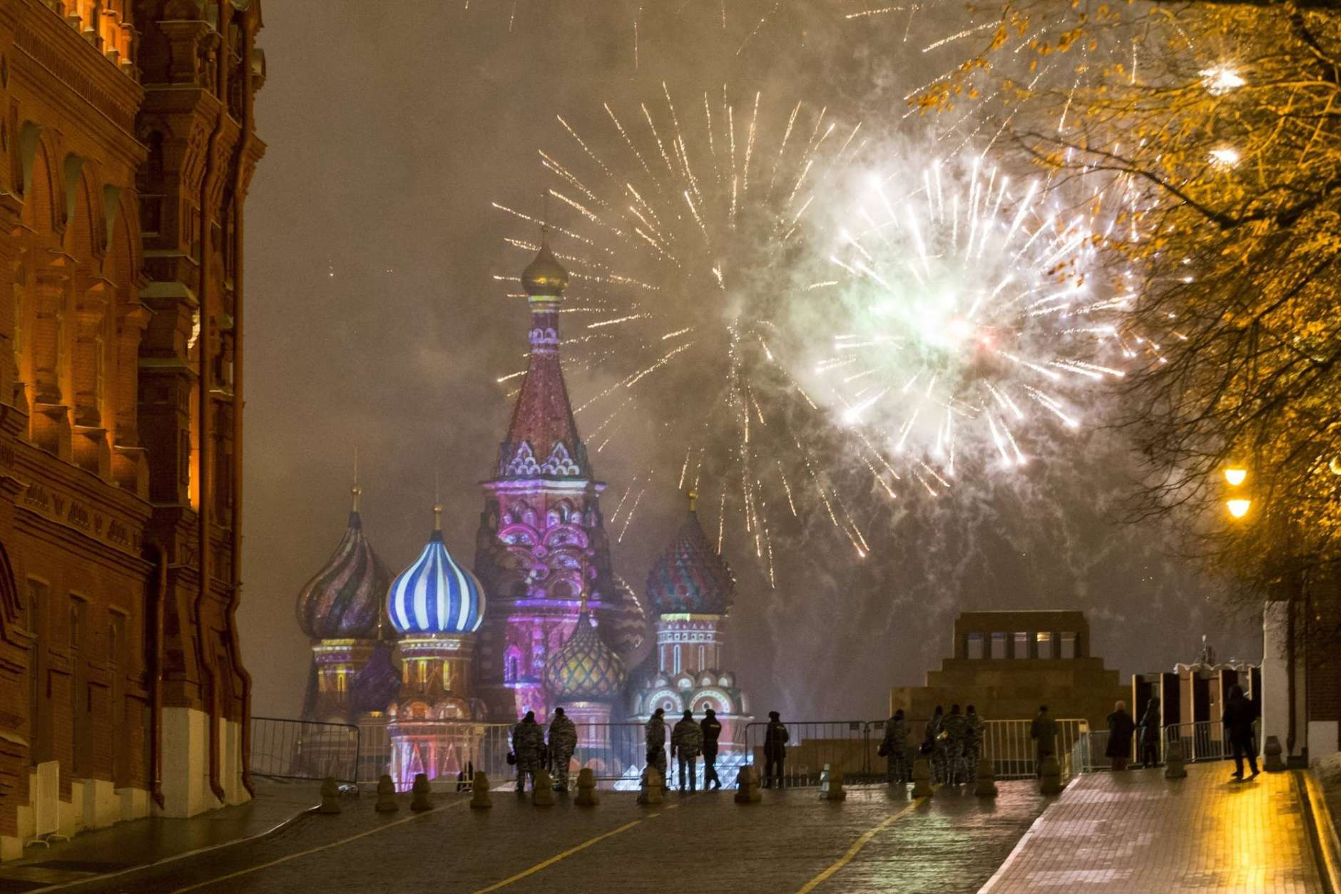 Fireworks explode over the Kremlin in Red Square which was blocked by police during New Year celebrations in Moscow, Russia, Sunday, Jan. 1, 2017. New Year's Eve is Russia's major gift-giving holiday, and big Russian cities were awash in festive lights and decorations. (AP Photo/Alexander Zemlianichenko Jr)