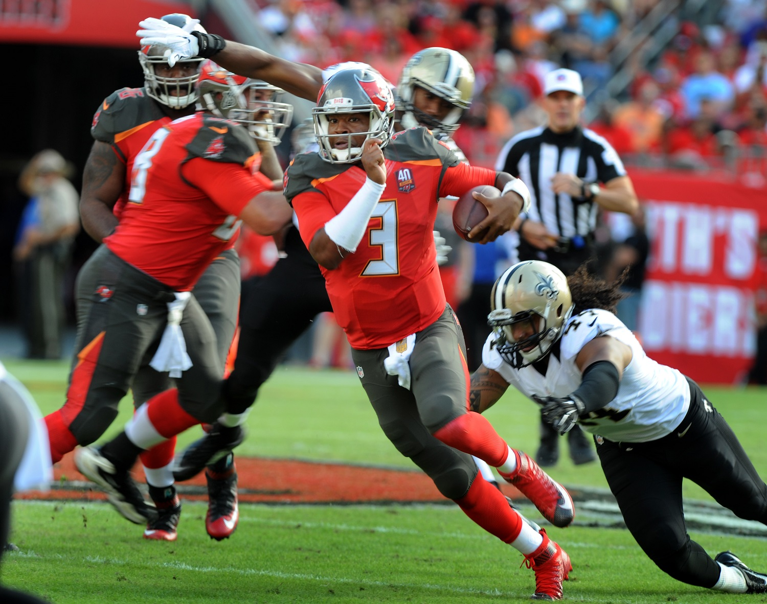 TAMPA, FL - DECEMBER 13: Quarterback Jameis Winston #3 of the Tampa Bay Buccaneers scrambles for a big gain in the second quarter against the New Orleans Saints at Raymond James Stadium on December 13, 2015 in Tampa, Florida. (Photo by Cliff McBride/Getty Images)