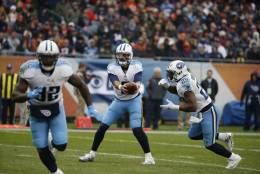 Tennessee Titans quarterback Marcus Mariota (8) hands off the ball to running back DeMarco Murray (29) during the first half of an NFL football game against the Chicago Bears, Sunday, Nov. 27, 2016, in Chicago. (AP Photo/Nam Y. Huh)