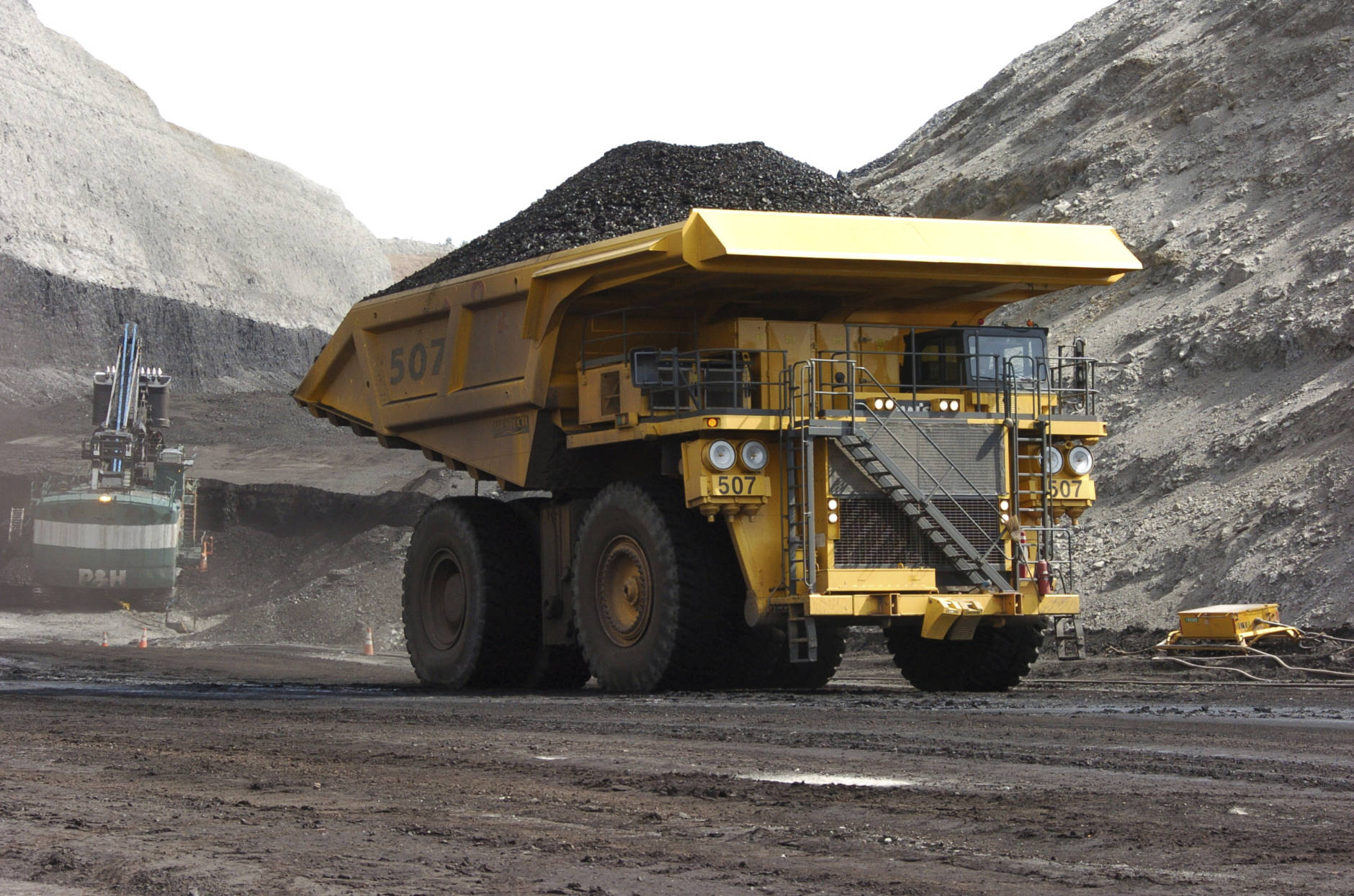 FILE - In this April 4, 2013, file photo, a mining dumper truck hauls coal at Cloud Peak Energy's Spring Creek strip mine near Decker, Mont. For conservatives who have long believed federal managers of America's vast public lands put more value on endangered owls than people and jobs, Donald Trump's election raises hopes for significant increases in oil and gas drilling, mining, grazing, timber harvesting and perhaps even a shift of control to state or local governments. (AP Photo/Matthew Brown, File)