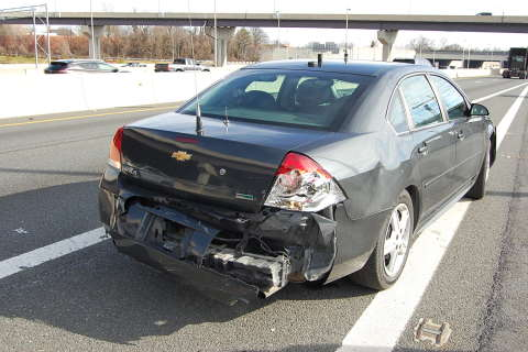 State Police: Va. woman charged after ramming police car