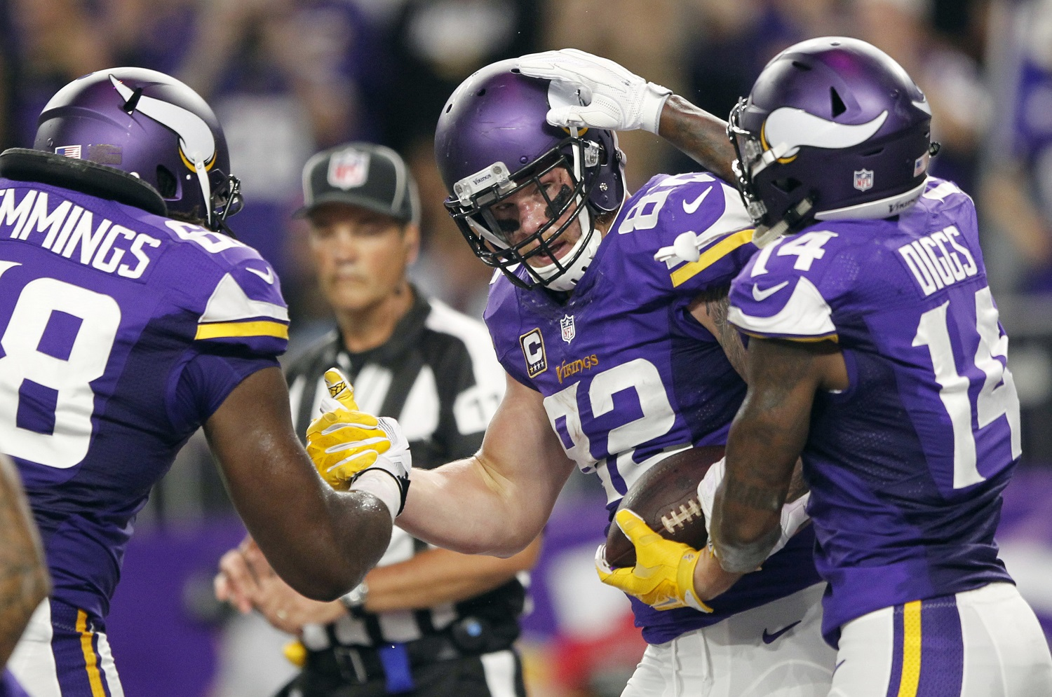 Minnesota Vikings tight end Kyle Rudolph, center, celebrates with teammates T.J. Clemmings, left, and Stefon Diggs, right, after catching a 7-yard touchdown pass during the first half of an NFL football game against the New York Giants on Monday, Oct. 3, 2016, in Minneapolis. (AP Photo/Andy Clayton-King)