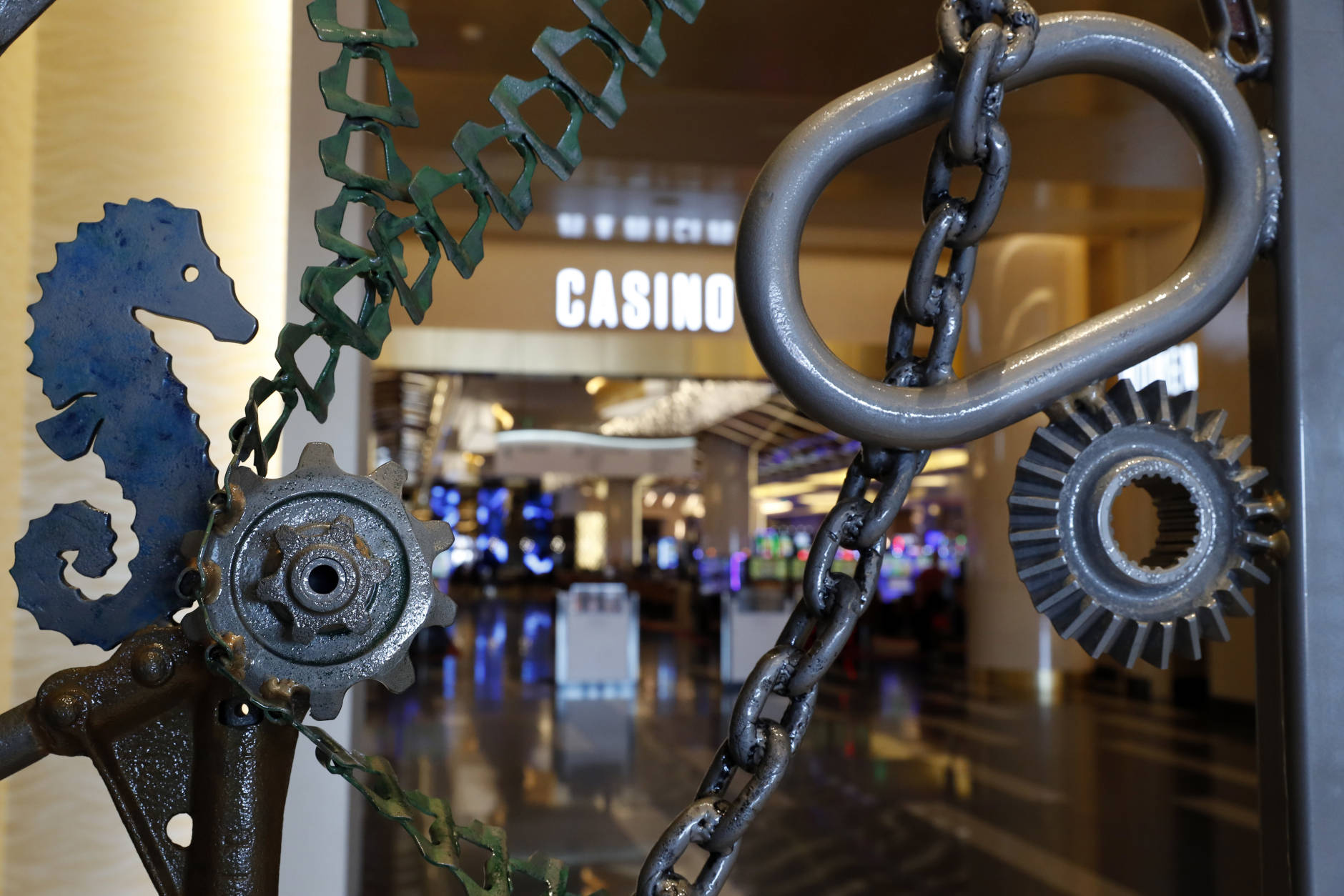"A portion of Bob Dylan's ""Portal,"" a metal collage with an aquatic theme, is seen during a preview tour of the MGM National Harbor, Friday, Dec. 2, 2016 in Oxon Hill, Md. With an An art collection of 72 pieces by 33 artists will flow throughout the casino and even outside. The $1.4 billion National Harbor casino and resort, just outside the nation's capital, is scheduled to open this week. (AP Photo/Alex Brandon)"
