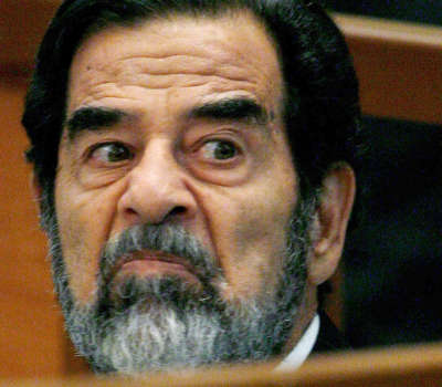FILE - In this Aug. 23, 2006 file photo, former Iraqi leader Saddam Hussein looks across the court during day 3 of the Anfal Campaign trial in Baghdad, Iraq. Former Liberian President Charles Taylor is part of a long parade of leaders guilty or accused of similar, and in some cases far more appalling, crimes in modern history. Here is what happened to some: Saddam Hussein: the former Iraqi dictator was hanged at age 69 after an Iraqi trial. His brutality kept him in power through war with Iran, defeat in Kuwait, rebellions by northern Kurds and southern Shiite Muslims and international sanctions. A U.S.-led invasion drove him from power in 2003. (AP Photo/Daniel Berehulak, Pool, File)