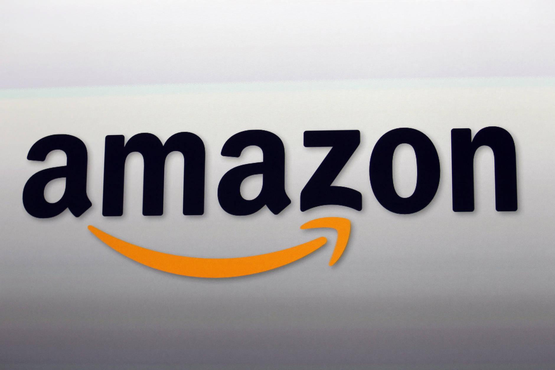 FILE - This Sept. 6, 2012, file photo, shows the Amazon logo in Santa Monica, Calif.  (AP Photo/Reed Saxon, File)