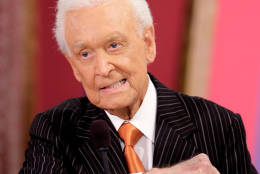 "** FILE **Television game show host Bob Barker gestures during live taping of ""The Price Is Right"" at the CBS Studios in Los Angeles, in this Oct.2006 file photo. A woman has sued Bob Barker and the producers of ""The Price is Right,"" alleging she was forced to quit working on the game show. (AP Photo/Damian Dovarganes, file)"