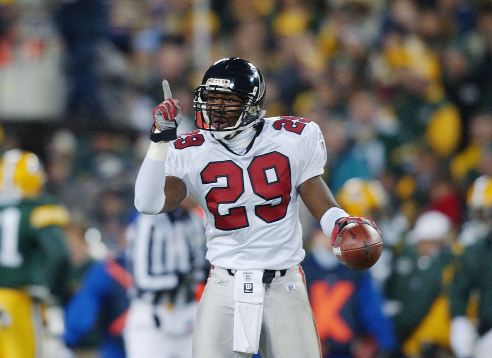 GREEN BAY, WI - JANUARY 4:  Keion Carpenter #29 of the Atlanta Falcons points to the sky as he celebrates after intercepting a pass against the Green Bay Packers at 8:33 of the first quarter of the NFC Wildcard game on January 4, 2002 at Lambeau Field in Green Bay, Wisconsin.  (Photo by Jonathan Daniel/Getty Images)