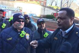 Battalion Chief David Mclain tells firefighters about another child to visit who is too ill to come outside. (WTOP/Krist King)