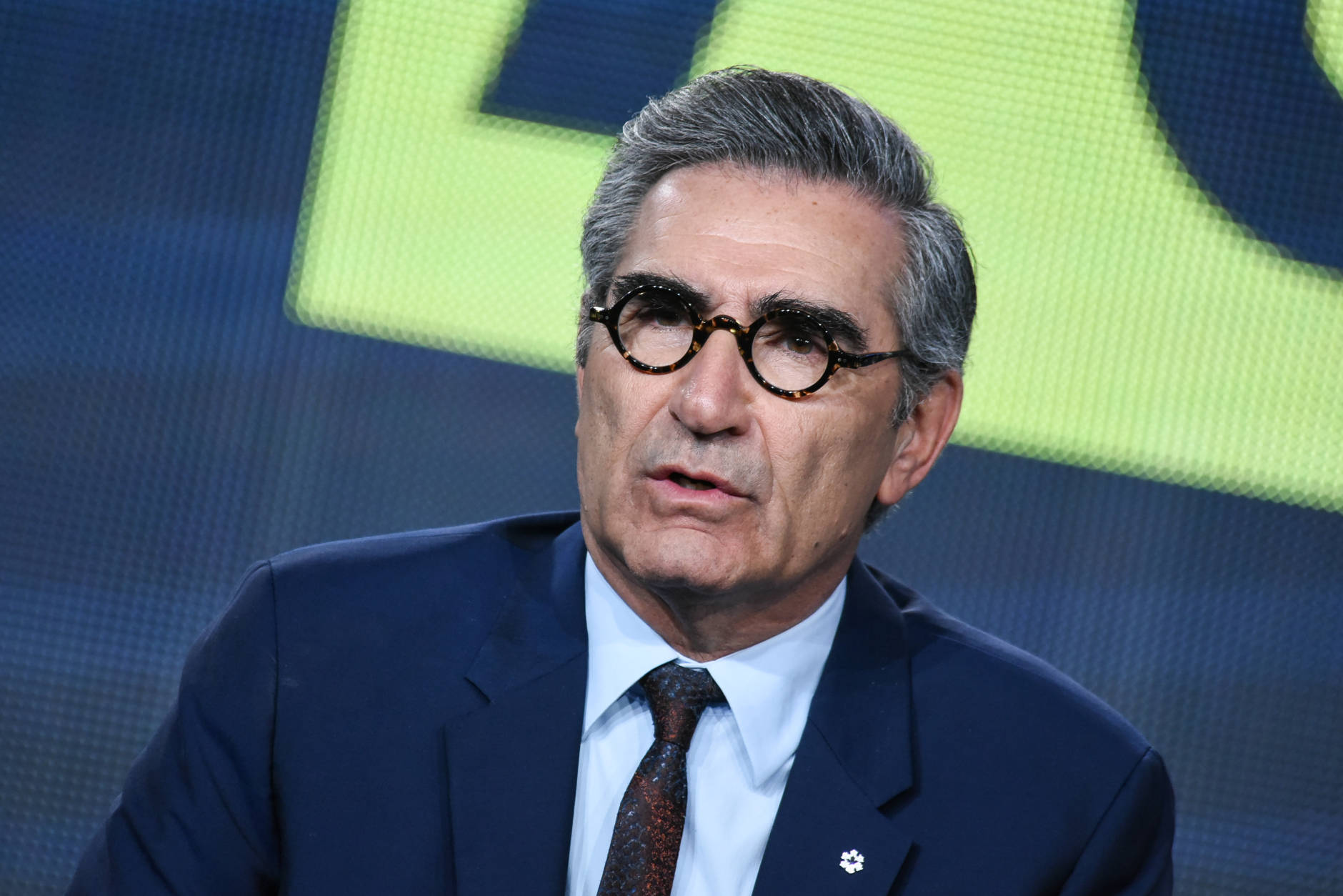 """Eugene Levy speaks onstage during the """"Schitt's Creek"""" panel at the Pop Network 2015 Winter TCA on Friday, Jan. 9, 2015, in Pasadena, Calif. (Photo by Richard Shotwell/Invision/AP)"""