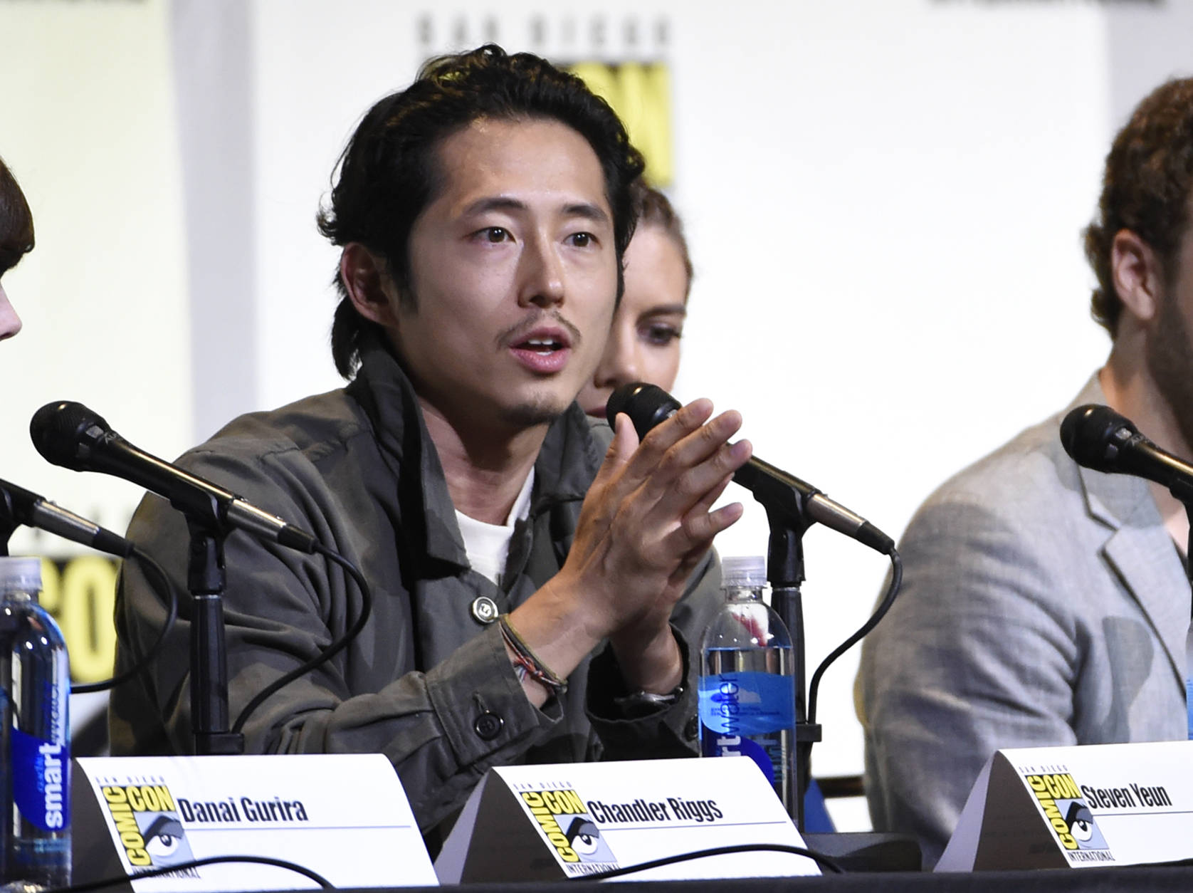 """Steven Yeun speaks during the """"The Walking Dead"""" panel on day 2 of Comic-Con International on Friday, July 22, 2016, in San Diego. (Photo by Chris Pizzello/Invision/AP)"""