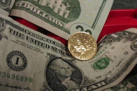 Gold coin given to Salvation Army kettle drive (Photos)