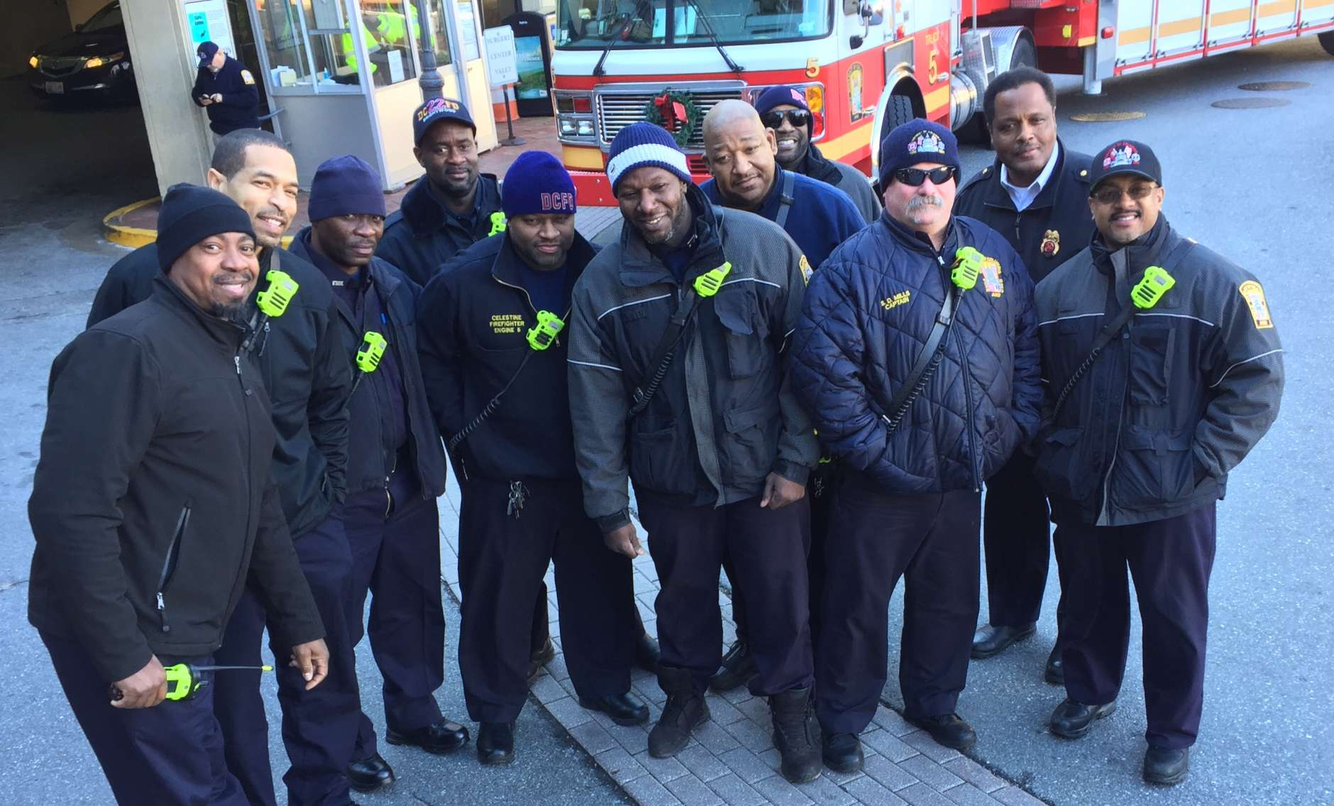 """Members of Engine 5 and Truck 5 are from fire houses in Palisades and Georgetown. """"We engage with kids a lot,"""" said Battalion Chief David Mclain. """"It makes our day."""" (WTOP/Kristi King)"""
