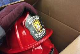 """Plastic firefighter helmets are given away to kids. """"We go to a variety of community events,"""" said D.C. Fire spokesman Vito Maggiolo. """"That's one way to attract the children to us, and then we can talk to them about fire safety."""" (WTOP/Kristi King)"""