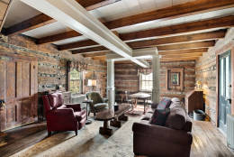 The original structure includes wide plank floors and a stone fireplace and chimney. (Courtesy Long & Foster Real Estate)