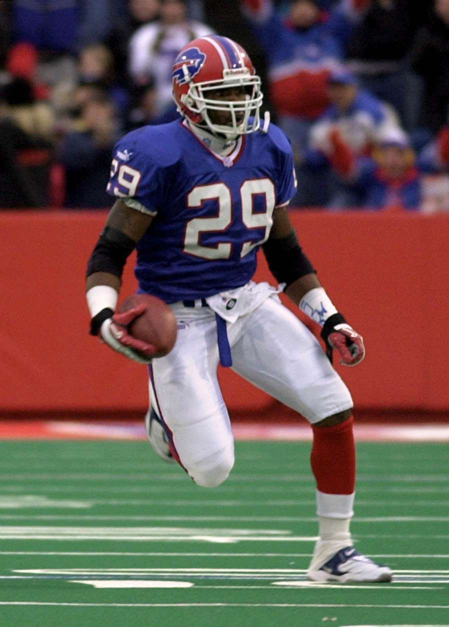 Buffalo Bills free safety Keion Carpenter returns an interception against the Chicago Bears on Nov. 12, 2000, at Ralph Wilson Stadium in Orchard Park, N.Y. Carpenter has emerged as one of the big surprises in a Bills defensive backfield that had been decimated by offseason salary-cap-induced departures. (AP Photo/Kevin Rivoli)