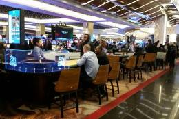 Guests of MGM National Harbor enjoy the facilities the morning after its grand opening. (WTOP/Kathy Stewart)