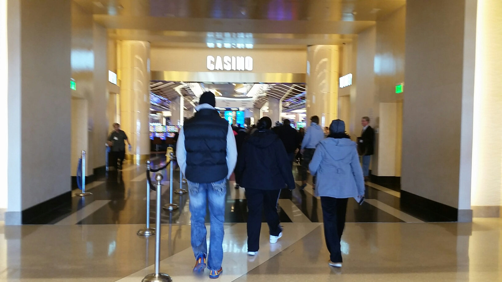 Guests continue to trickle into the casino area of the MGM National Harbor following Thursday's grand opening at 11 p.m. (WTOP/Kathy Stewart)