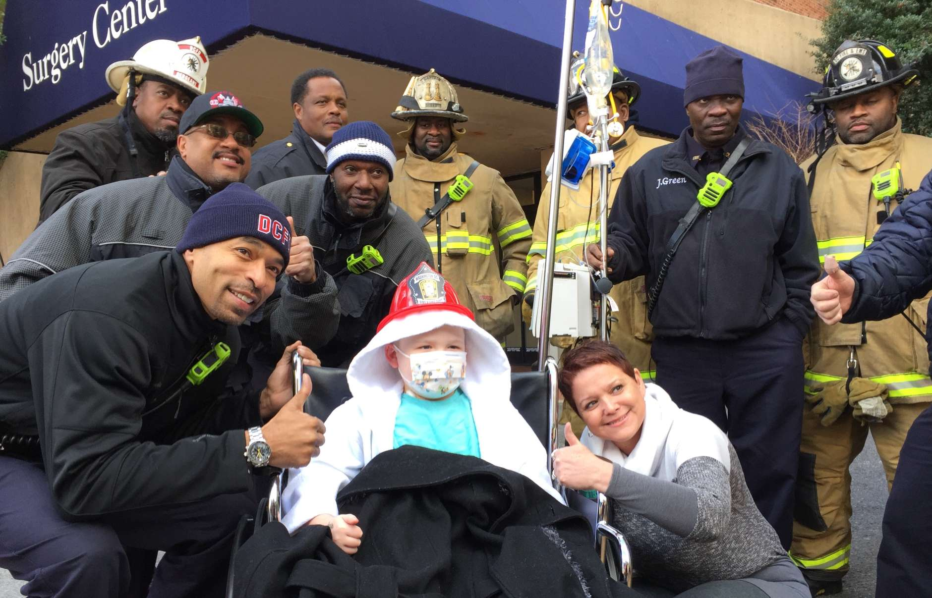 Hunter's mother, Kym Scarborough, draped her child's lap with her coat when they came outside and discovered how cold it was for the firefighter visit. (WTOP/Kristi King)