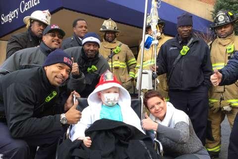 DC firefighters visit sick boy in hospital