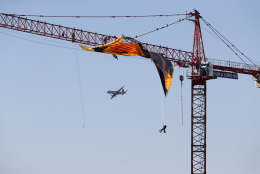 """An airplane flies by the construction site of the former Washington Post building in Washington, Wednesday, Jan. 25, 2017, where Greenpeace protesters unfurled a banner that reads """"Resist."""" (AP Photo/Carolyn Kaster)"""